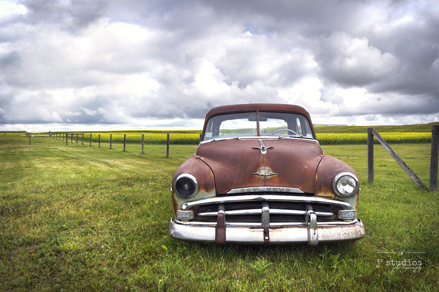 Art print of a weathered 1950s Dodge Plymouth sitting in a farmers field in Alberta. Canadian Prairies photography.