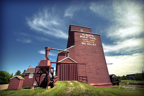 Jewel of Big Valley is an image of a red Alberta Wheat Pool grain elevator. Heritage inspired landscape photography.