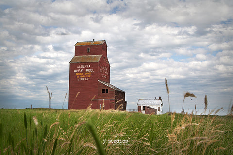 Gorgeous image of the weathered grain elevator in the community named after Anna Esther Landreth, who was a girl who lived there. Canadian prairie photography.
