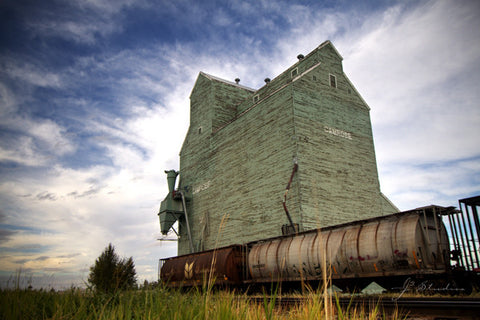 Last Stop in Camrose is an art print of grain elevator in Camrose, Alberta. Heritage photography.