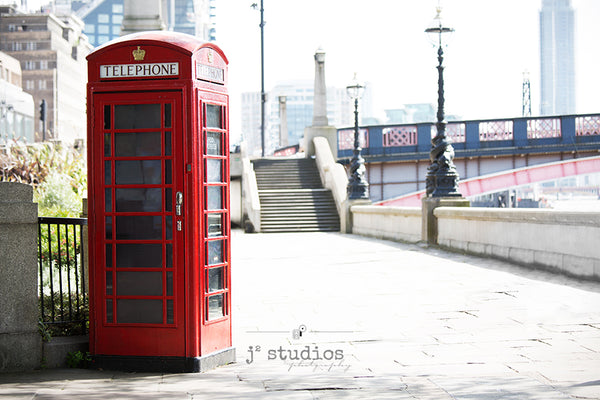 Fine art prtint of a red telephone booth along the waterfront of London, England. Landmark photography.