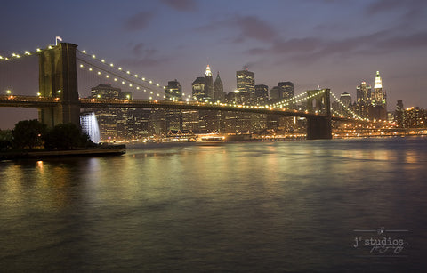 Manhattan at Night is an image of the iconic New York City skyline and the Brooklyn Bridge.