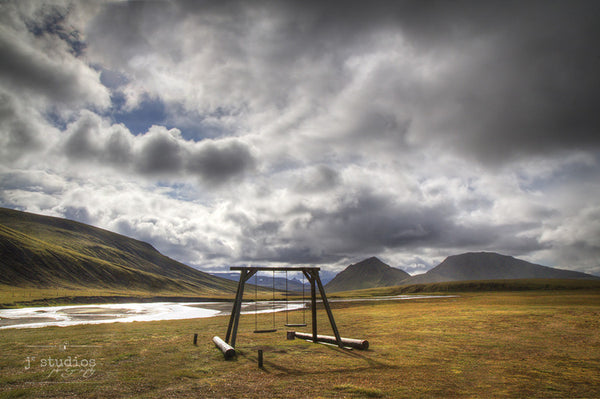 Mountain Playground is an image  the a swing set in the highlands of Iceland.