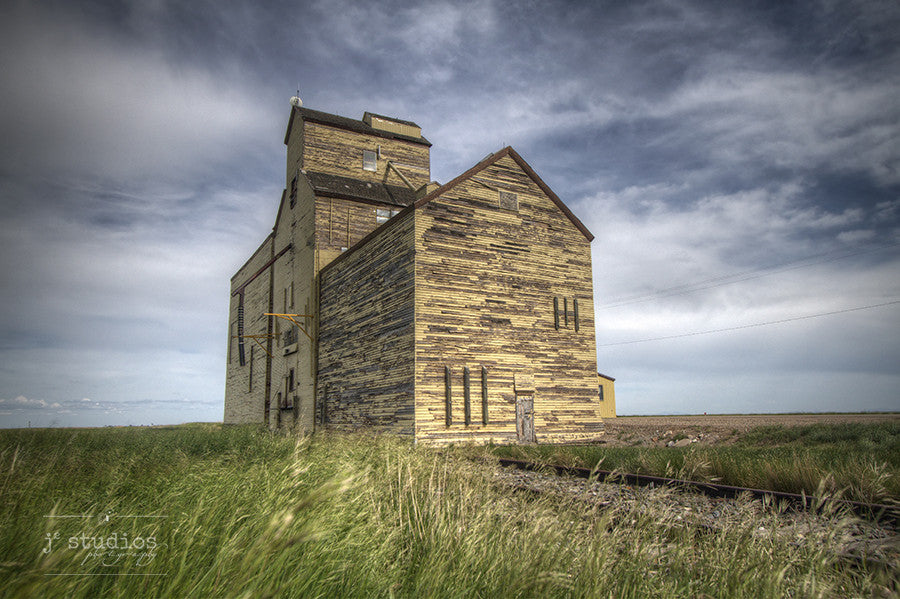 Old Memory on the Prairie is an art print of the grain elevator in Skiff, Alberta. Heritage themed railroad photography.