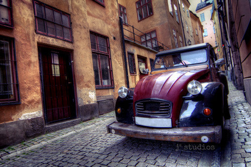 Old Town Charm is an art print of a European jalopy in Stockholm Sweden.