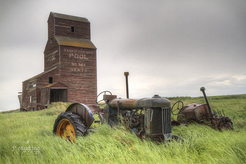 Parked in Bents is an image of an abandoned tractor and grain elevator in this ghost town in Saskatchewan, Heritage photography.