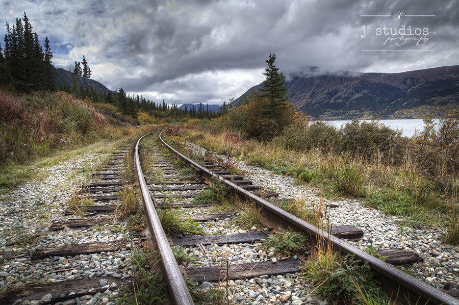 Path to the Yukon is an image of the train tracks curving off into the autumn horizon near Carcross. Railroad Photography.