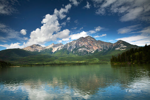 Image of the iconic Pyramid Mountain looming over Pyramid Lake in Jasper National Park, Alberta, Canada.