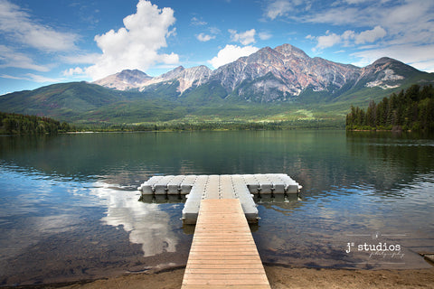 Art print of a pier bridging the shores of Jasper National Park and Pyramid Lake. Best images of Alberta.