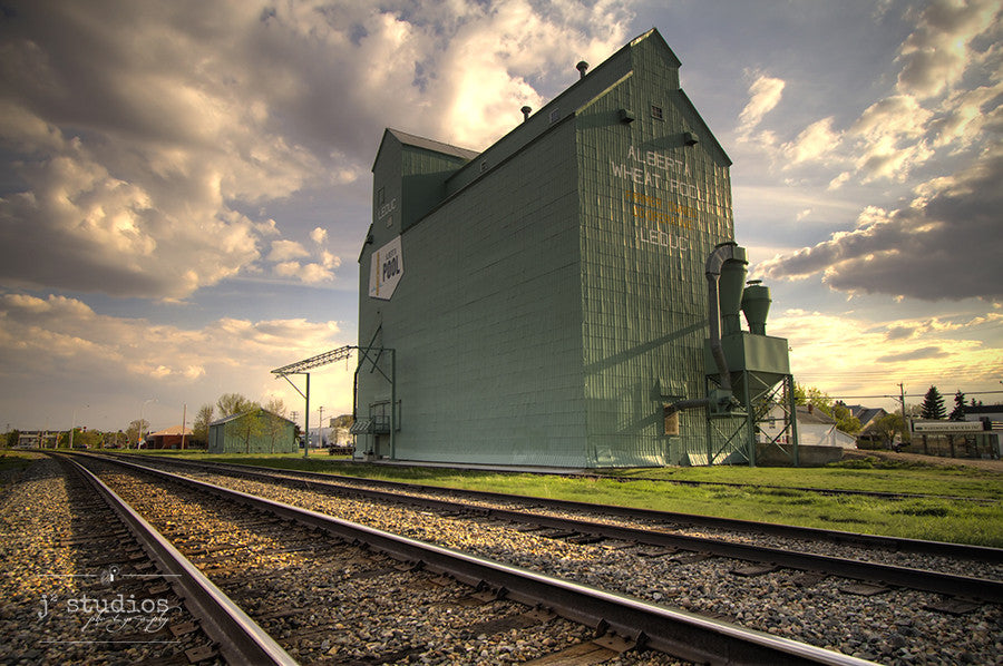 Sentinel on the Tracks is an image of the grain elevator in Leduc, Alberta. Photography of prairie architecture.