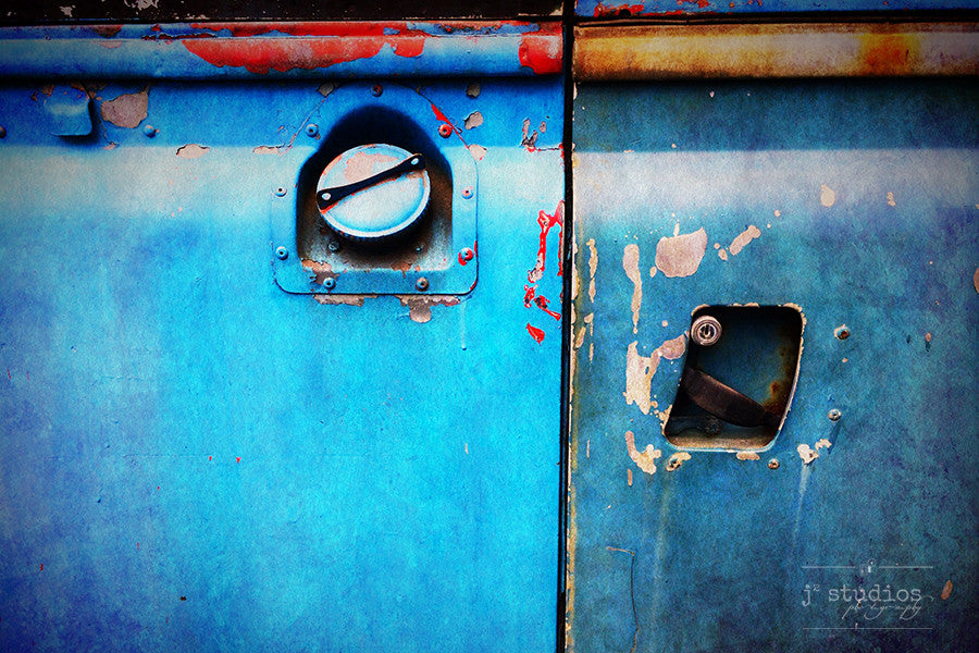Shades of Blue is a photograph print of the gas cap and handle of an electric blue Land Rover in Norway.