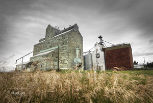 Standing in Three Hills is an art print of a pair grain elevators in Central Alberta. Heritage Photography.