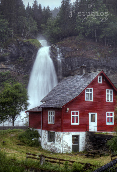 Steinsdal's House is an art print of a Norwegian red house with a waterfall view. Scandinavian Photography.