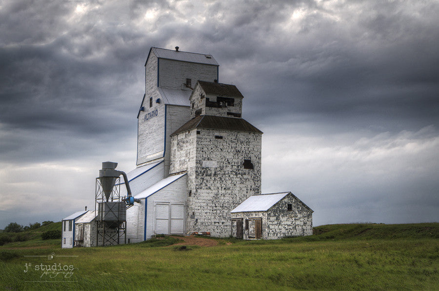 Still Standing in Altario is an art print of the grain elevator in Eastern Alberta. Storm Cloud Photography with heritage themes.
