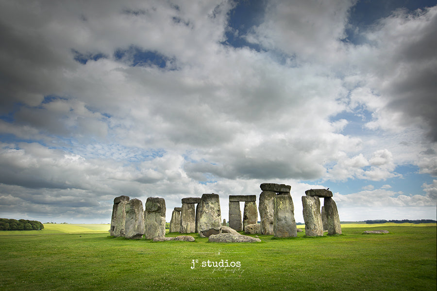 Timeless image of the famous prehistoric monument in Wiltshire, England. Iconic ring of standing stones ancient burial ground. English Heritage Photography.
