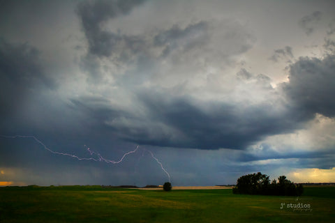Storm Struck is an image of a lightning electrifying the Alberta prairie skies near Edmonton. Weather photography.