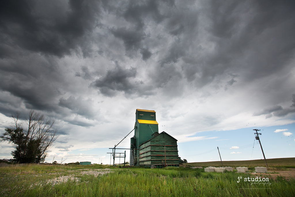 Image of the weathered Grain Elevator in Delia, Alberta moments before the storm.  Dramatic Big Sky photography.