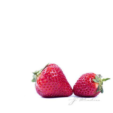 Strawberry Kisses is a minimalist inspired photograph of a fresh pair of red strawberries sitting cheek to check like lovers. Kitchen decor, Fruit art. Whimsical decor by J2 Studios