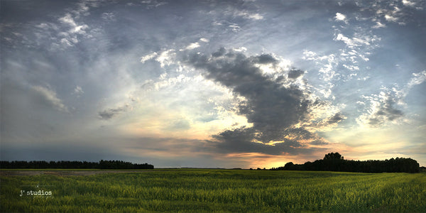 Summer Sunset is an image of the big Alberta Sky setting on Heritage Valley in Edmonton. Panorama photography.