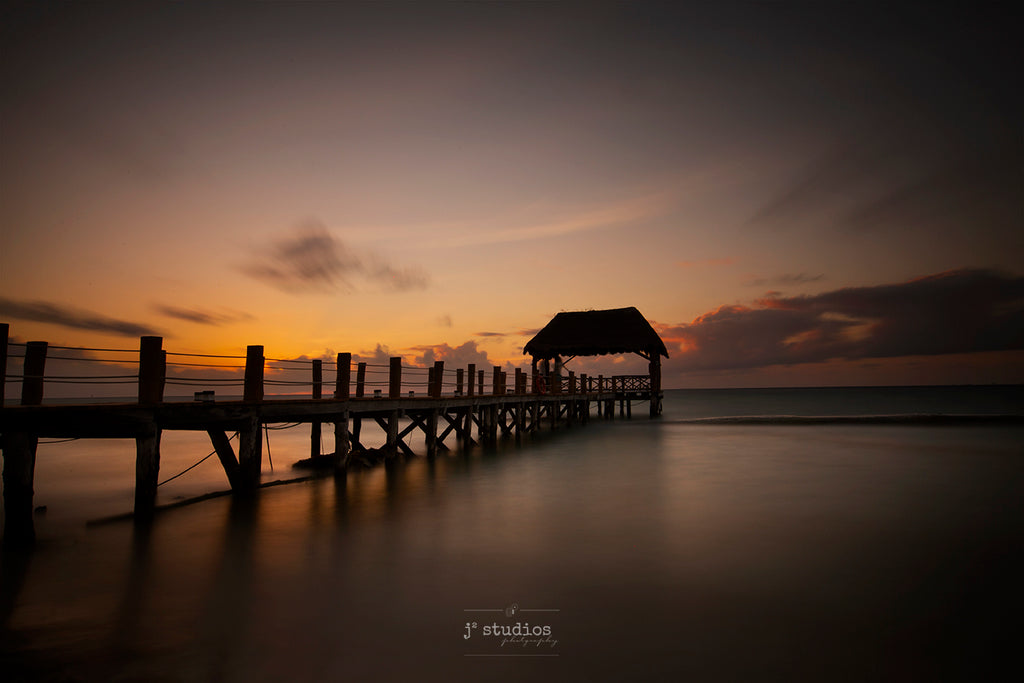 Art print of a Gazebo on a wooden pier in The Fives Azuls Beach Resort in Playa Del Carmen, Mexico. Peaceful waters of Caribbean Sea. Print by artists Larry Jang.
