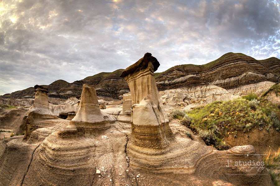 The Hoodoos is an image of the iconic rock formations sitting in Drumheller, Alberta. Badland landscape photography.