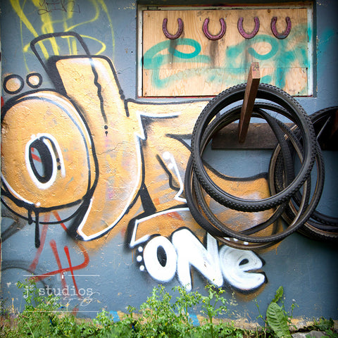 Tired Art is a graffiti themed image about bike tires. Urban Photography.