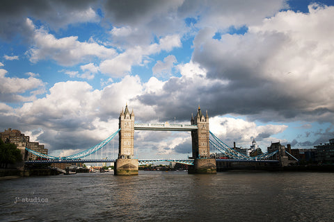 Image of the famous landmark in London, England called Tower Bridge. Dramatic travel themed photography.