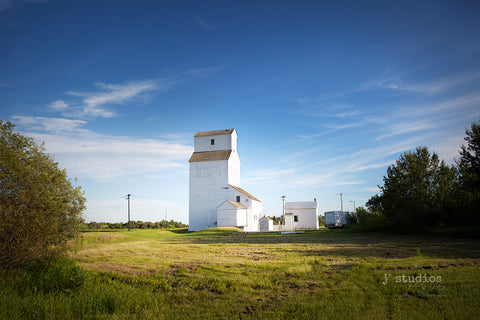 Photograph of the Krause Milling Company Grain Elevator in the Hamlet of Radway, Alberta. Historical places photography.