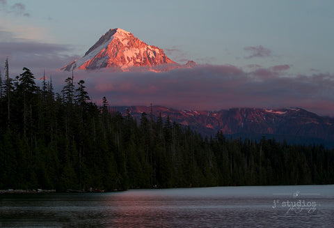 Twilight on the Hood is an image of Mount Hood looming over the evergreen forest of Lost Lake in Oregon.