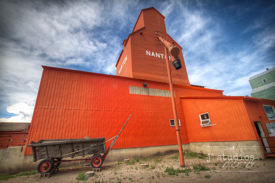 Art print of the beautiful orange grain elevator in Nanton, Alberta. Canadian Prairies photography.