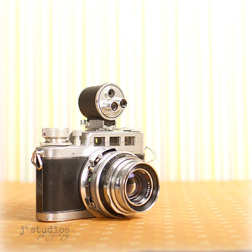Vintage Camera #15 is an art print of the Diax IIa Rangefinder Film Camera made by W Voss.
