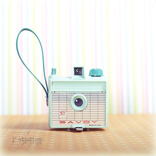 Vintage Camera #7 is an art print of a mint green Imperial Savoy film camera from the 1960s.