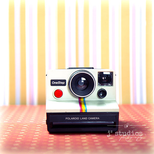 Vintage Camera #3 is an art print of the 1980s Polaroid Instant One Step Film Camera.