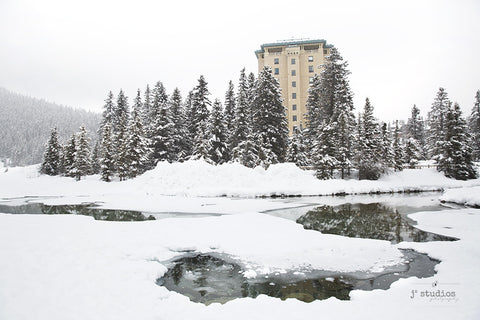 Image of Chateau Lake Louise in romantic winter wonderland of Banff. Rocky Mountain Photography.