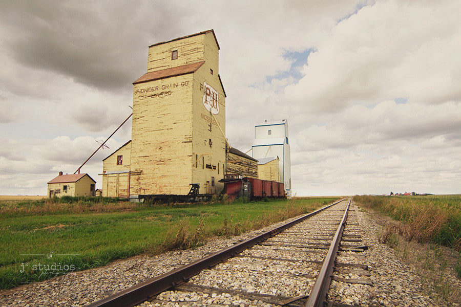 Your Heritage Will Bring You Home (No Words) is a sentimental themed image of Mossleigh's grain elevators. Alberta Photography.