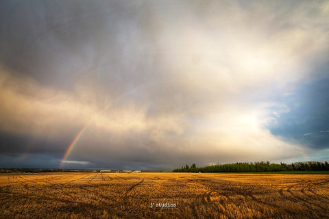 Double Rainbow arcing over a farmers field in Heritage Valley in South Edmonton.