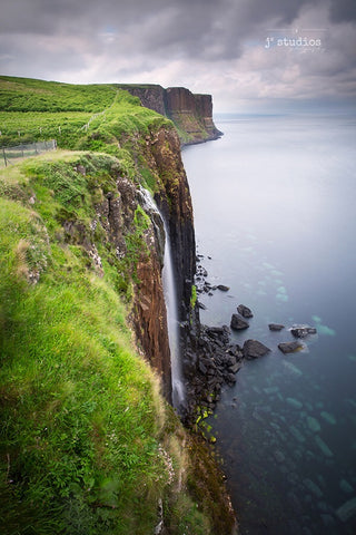image of Mealt Falls cascading into the ocean Kilt Rock