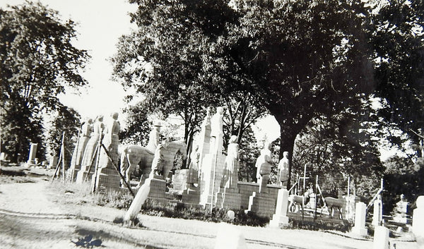 Surreal Cemetery Rows of Statues Photograph