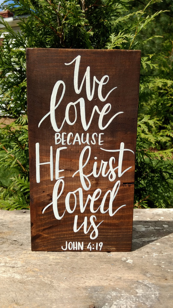 We love because he first loved us wood sign