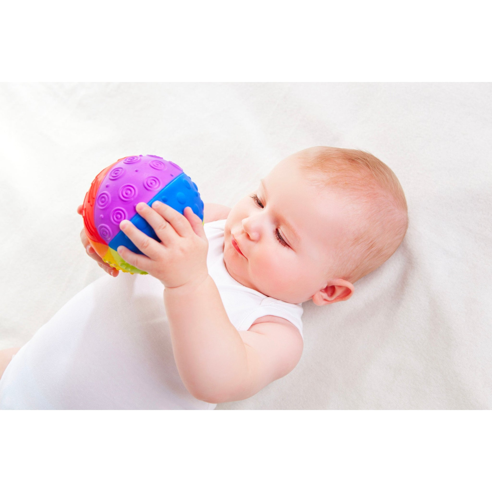 Natural Rubber Rainbow Sensory Ball Caaocho Baby Gifts at Little Earth Nest Eco Shop