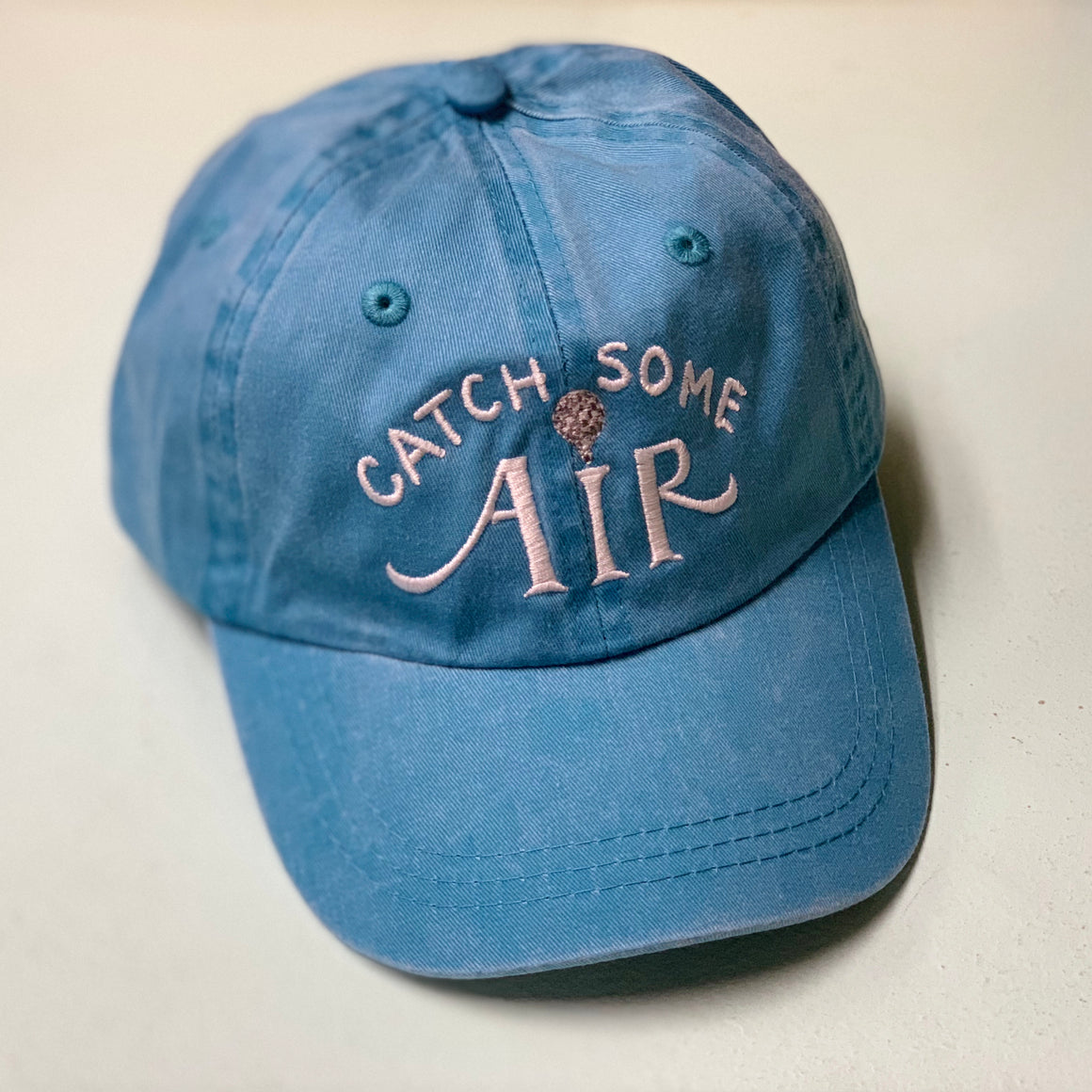"""CATCH SOME AIR"" kids baseball cap/faded"