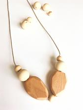 wood natural teething necklace for mum to wear and baby to chew.  A lovely way for stylish mums to still wear jewellery with teething babies in tow. The ideal baby shower gift. Based in Malta and Denmark, Europe.