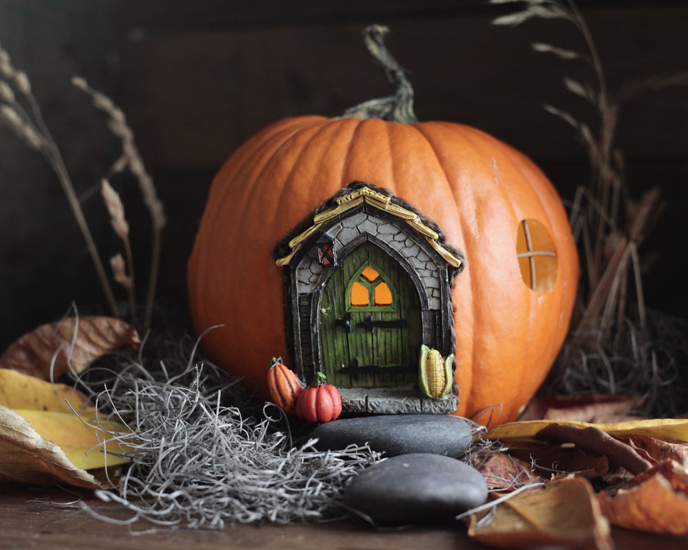 Fairy pumpkin house for a Halloween fairy garden