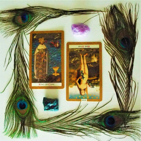 peacock feathers tarot cards crystals