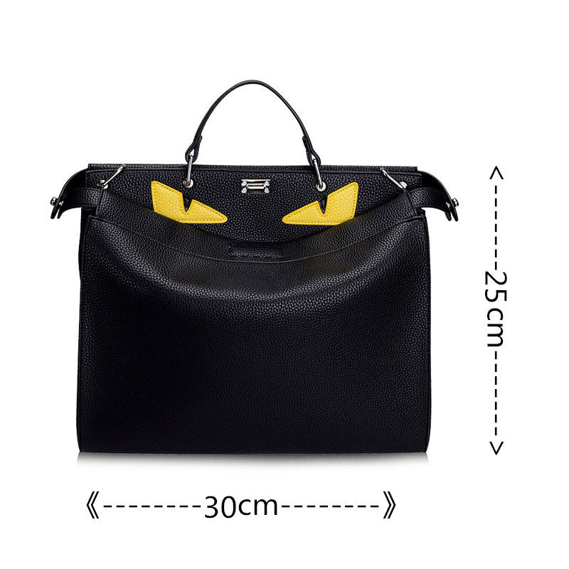 Luxury Leather Yellow Eye Handbag - Great for laptop