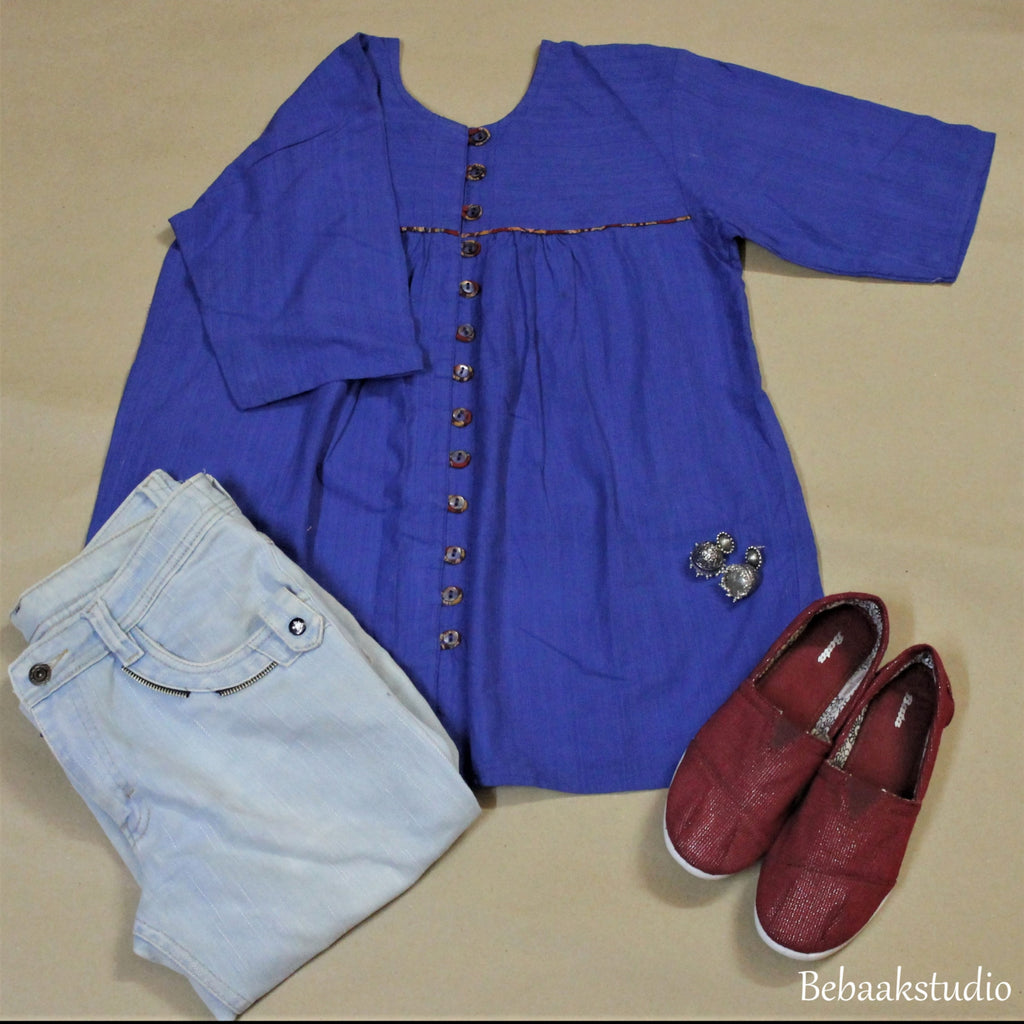 Wardrobe essential: Gathered loose fit top and shirt