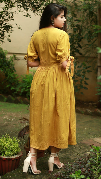 Earthy yellow puff sleeve midi dress