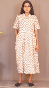 Beige geometrical blockprint pleated cotton long dress by bebaak