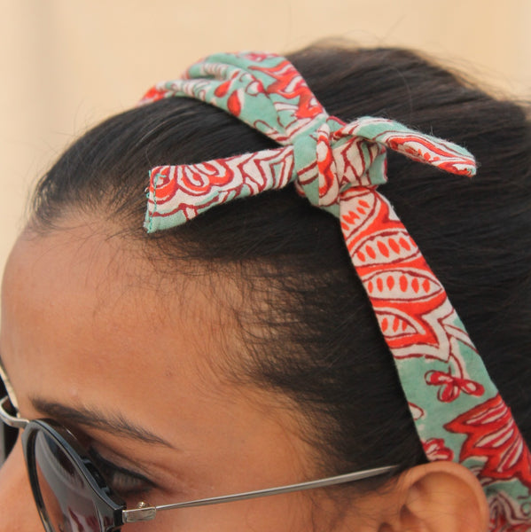 Green block print knotted bow headband