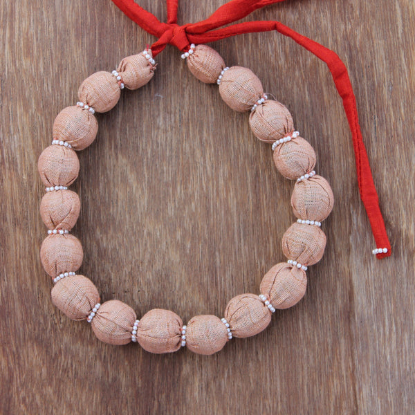 Updcycled textile necklace peach color beaded
